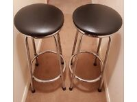 Two black rotatable stools