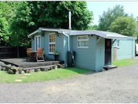 INSULATED 3 BEDROOM WOODEN LODGE,WOOD BURNER,PORCH, UPVC DOUBLE GLAZING,BATHROOM, not static caravan