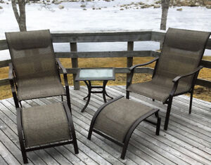 Patio Chairs with two footstools and shared table