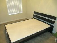 MALM IKEA king size bed with mattress and bedside tables