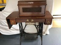 Vintage Singer Sawing Machine with work surface table and metal frame