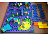 Happyland set incl. train and road track, shops, people and vehicles.