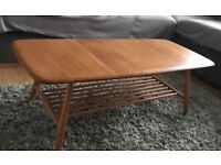 Ercol blonde coffee table with magazine rack