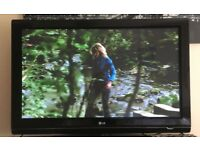 "Black and Silver LG 42"" Plasma TV in excellent condition"