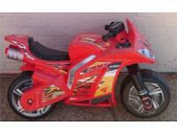 Push along motorbike and crash helmet