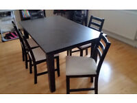 Extendable Ikea dining table and 6 chairs