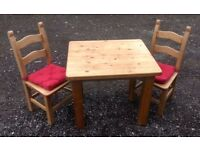 Solid Wood Table and Two Chairs (with removable cushions)