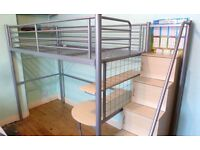 Metal frame high sleeper with wooden steps, desk and single futon