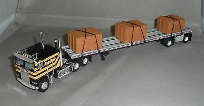 1/64 DCP BLACK/ORANGE KENWORTH K-100 W/ CRATE LOAD