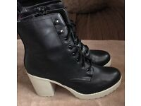 Black boots with white sole and heel
