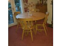 Antique pine circular dining table and chairs good condition