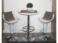 NOW SOLD Two white gas-lift bar stools