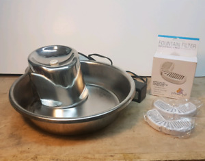 Pet water fountain. Great for dog or cat. Includes 2 spare filte