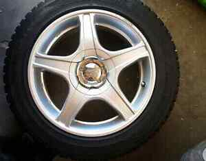 Set of gently used winter tires with rims