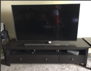 "Tv 55"" with a table."