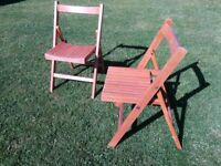 Vintage 1950s folding chairs, solid wood in good condition.