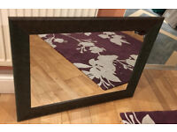 Large leather edged mirror
