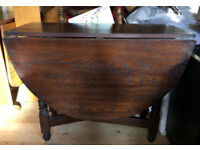 Selection of different solid wooden or veneer drop leaf tables some with chairs
