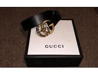 Gucci GG black leather belt with gold/bronze snake buckle. Comes with box and dust bag.