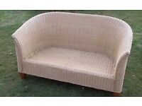 Vintage natural cane wicker settee. 1.2m wide x 70cms deep x 70cms high