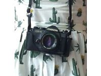 Retro 80's Chinon SLR camera, 50mm lens and leather case