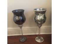 Two very pretty large goblets one black crackle glazed and one silver.