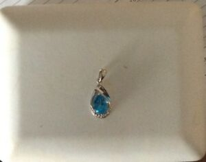 Diamond and Topaz Pendant, With Appraised Value $998