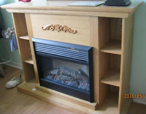Fireplace and mantle with electric heater