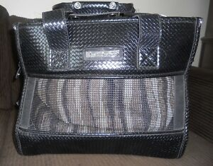 Cat carrier, breathable, expensive Small Treasures, $25.