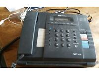 INTEGRATED PHONE AND FAX MACHINE