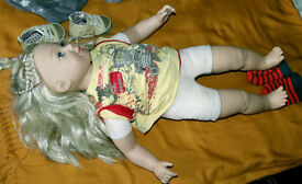 Doll 60 cm high. Arms, head,legs from silicon, body from fabrik. Some clothes are on the pictures
