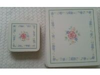 6 white and blue floral table mats and matching coasters