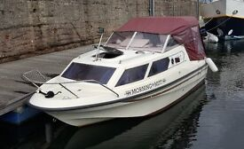 Shetland Family Four motor boat with 90hp outboard and trailer