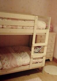 Cream bunk beds