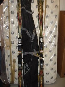 Skis with case and goggles