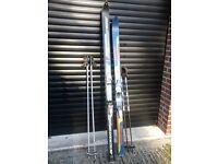 2 Pairs of Skis