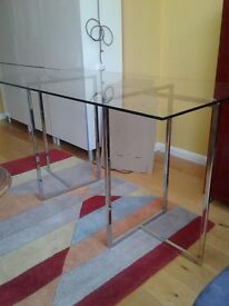 Glass top table with chrome legs