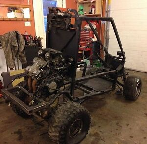 Golf cart frame with motor