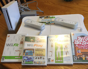 Wii console with base and games