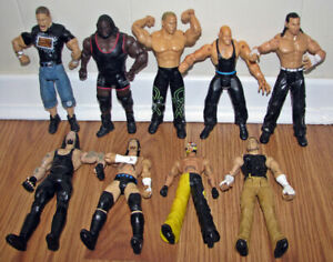 8 WWE Wrestling Action Figures and 1 WCW Action Figure