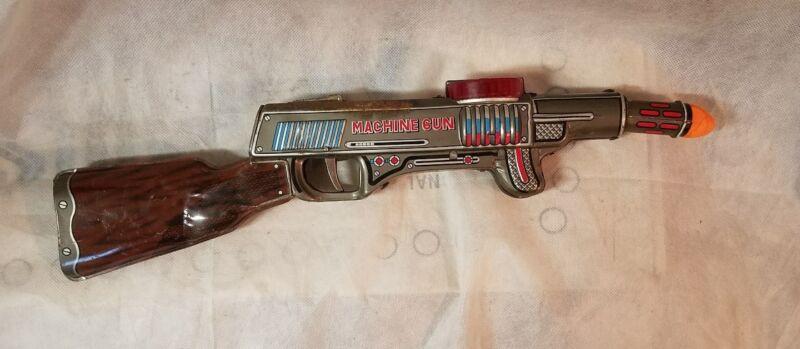 Vintage 1960s Nomura TN Japan Tin Friction toy machine gun (RARE)