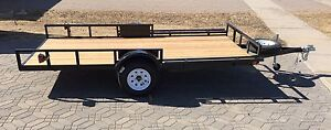 """Utility trailer, 12'x64"""", tilted"""