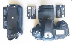 Nikon d 100 battery grip and 28-80 mm lens
