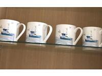 Four mugs .