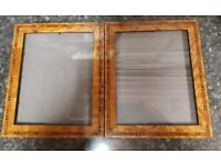 Two Picture Frames. Highly polished wood with edging design.