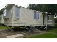 Modern 6 berth caravan at hoburne naish .