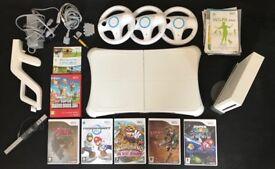 Nintendo Wii + games, gun, balance board & steering wheels