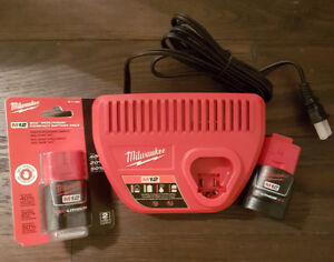 Brand New Milwaukee M12 2.0ah and 1.5ah batteries with charger