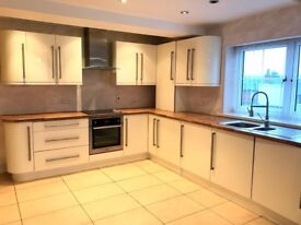 Two bedroom, one bathroom apartment in Prescot, just one year old with parking space