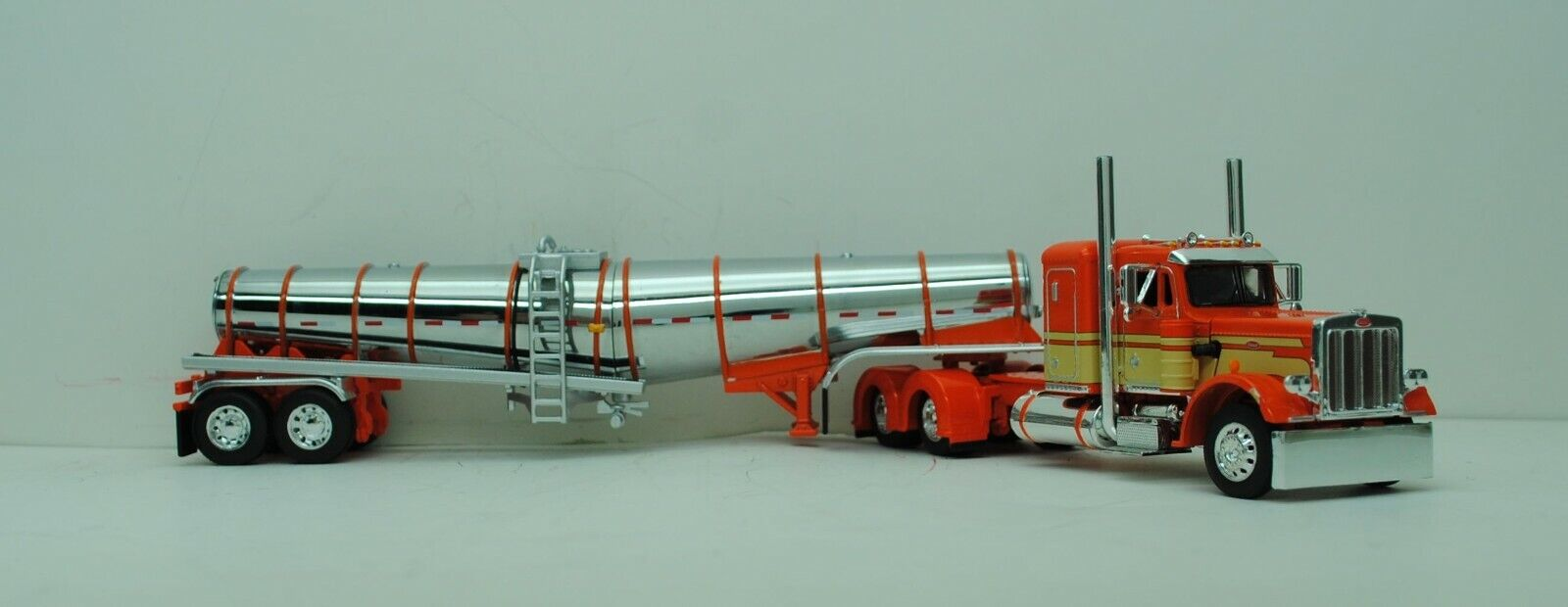DCP 1/64 SCALE 359 PETERBILT SMALL BUNK ORANGE, CREAM & POLAR TANKER  #60-0769 1